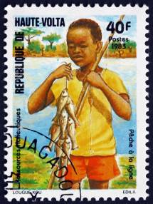 Postage stamp Burkina Faso 1983 Boy fishing